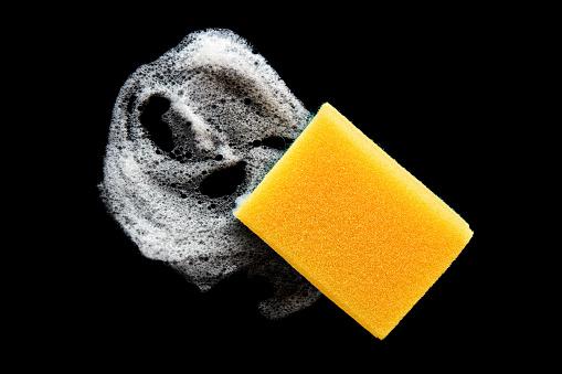 istock Dishwashing sponge with foam isolated on black background 1222801239