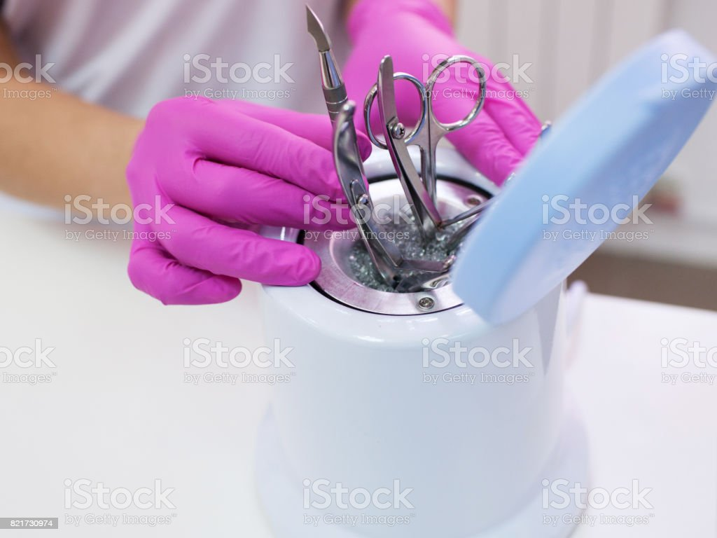 Disinfection of metal manicure tools. stock photo