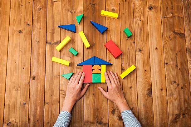 Disjointed building blocks stock photo