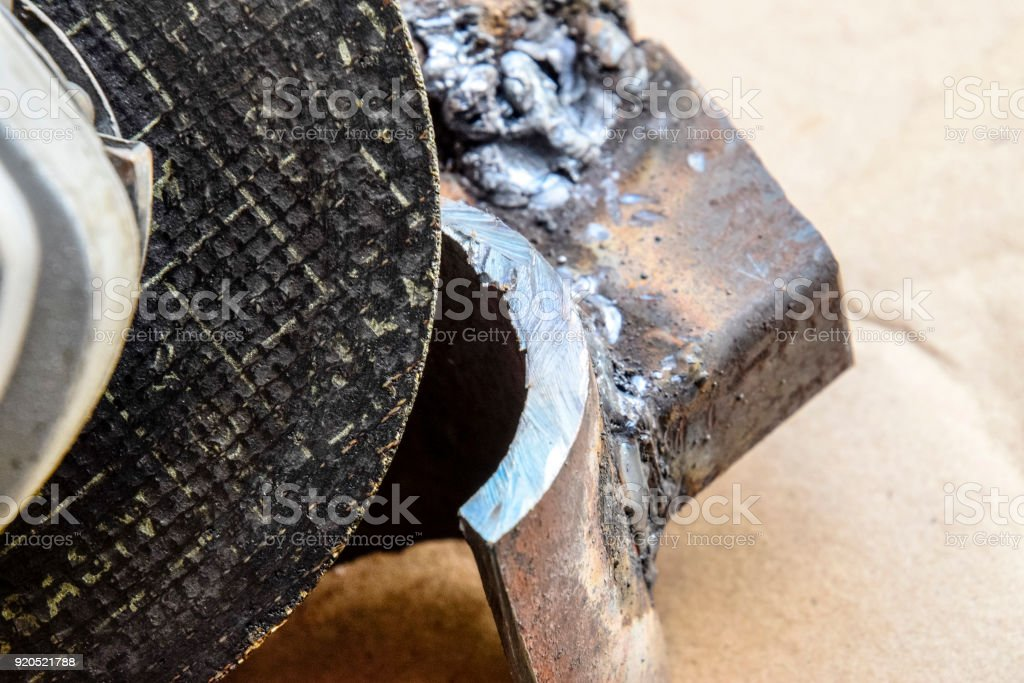 disk Angle grinder. Tool for working with metal. The working disk. detail, polished by the Bulgarian. stock photo