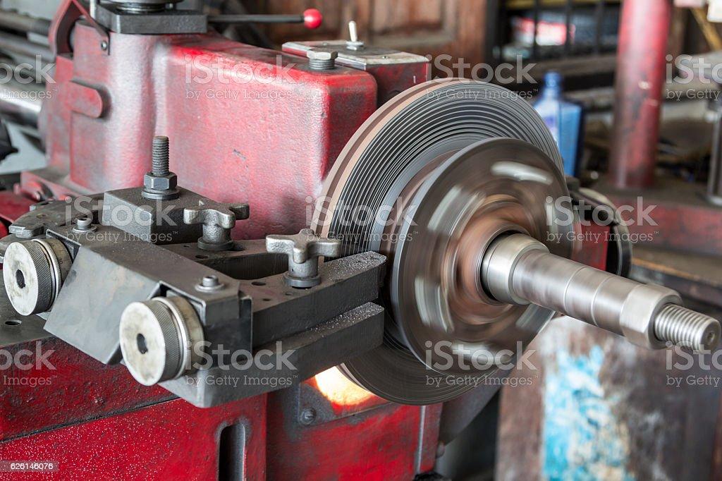 disk brake machine working to rebuild serface stock photo