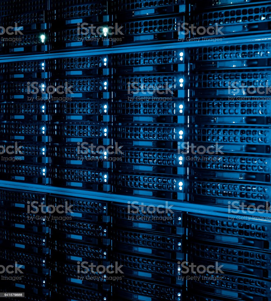 disk storage as the background of close-up hard drives in data center room stock photo