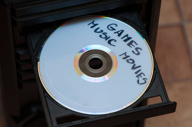 disk with games, music and movies stock photo