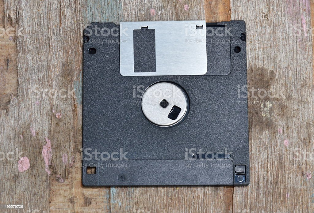 diskette on wooden board stock photo