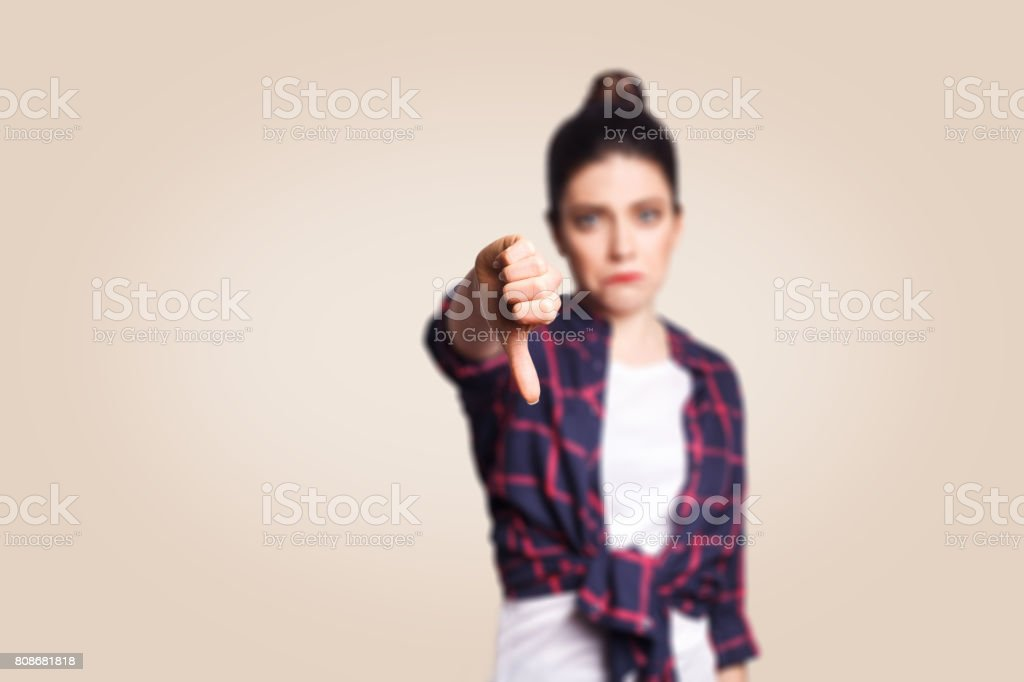 Dislike. Young unhappy upset girl with casual style stock photo