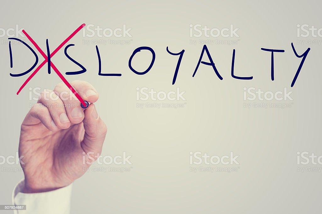 Disloyalty versus loyalty stock photo