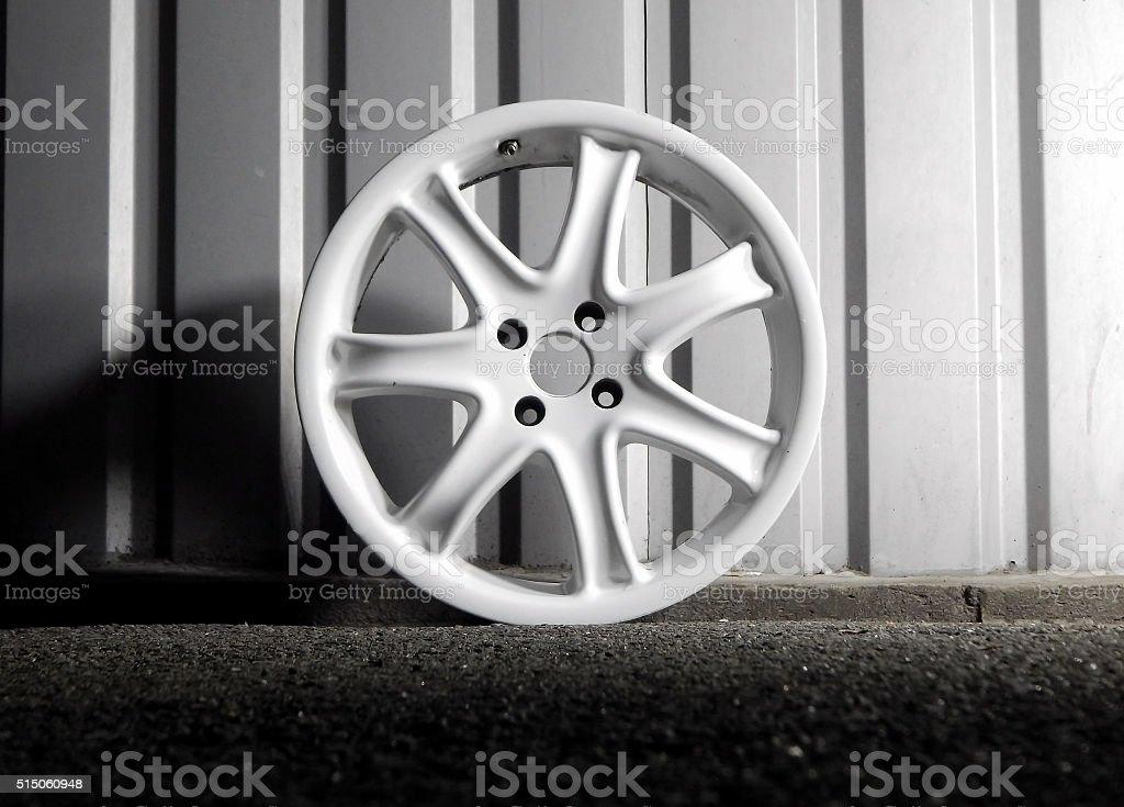 Dismantled custom racing car wheel isolated stock photo