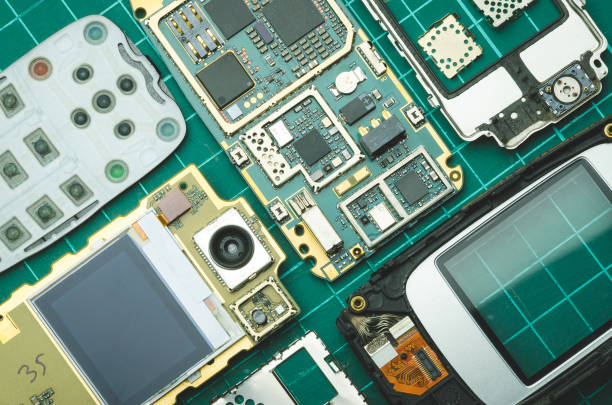 dismantled for spare parts old mobile phone on green background