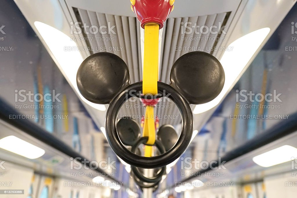 Disney MTR Hong Kong - October 4, 2016 : Mickey Mouse Handle on Disney-themed subway taken on October 4, 2016 in Hong Kong. Disney subway only runs between 2 MTR stations in Hong Kong - Sunny Bay station to Disneyland Resort station. Editorial Used Only Activity Stock Photo