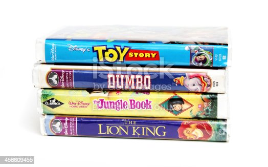 West Palm Beach, USA - August 29, 2011: This is a product shot of a stack of four Disney vintage VHS tapes, including such popular movie animations as The Lion King, Toy Story, Dumbo, and the  Jungle Book.