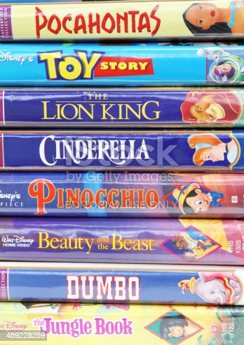 West Palm Beach, USA - August 29, 2011: A collection of Disney vintage VHS tapes, including such popular movie animations as The Lion King, Toy Story, Dumbo, Cinderella, Beauty and the Beast, Pinocchio and others.