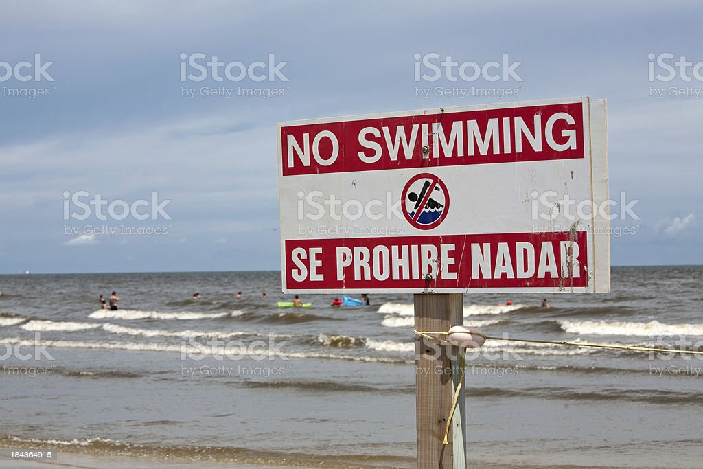disobedient swimmers at beach stock photo