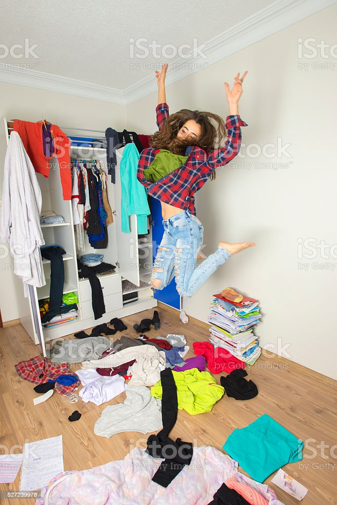 Disorder and mess at home. Cheerful young girl.Disorder and mess at...