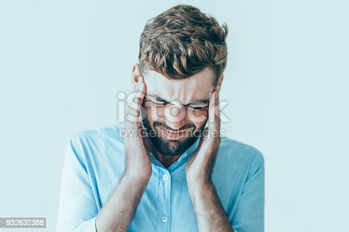 istock Disordered Young Man Suffering from Headache 932632388