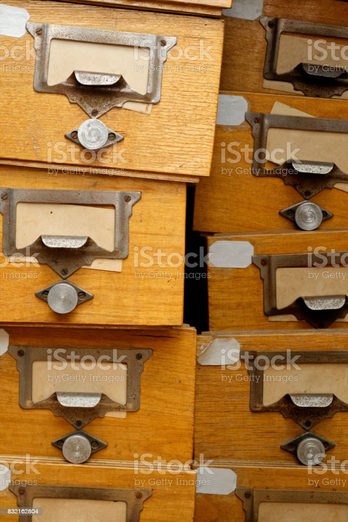 Disorderly group of old wooden drawers royalty-free stock photo