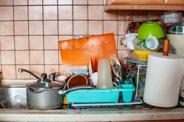 Disorganized, Messy Kitchen Disorganized, Messy Kitchen greed stock pictures, royalty-free photos & images