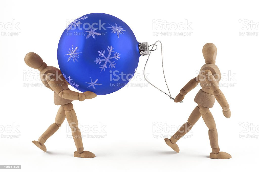 Disparate christmas jobs - Wooden mannequins at work stock photo