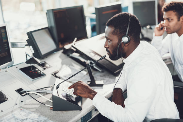 Dispatcher speaking by microphone on navigation board stock photo