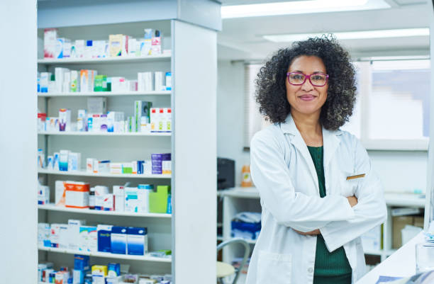 Dispensing top quality medicine is what I do Portrait of a confident mature woman working in a pharmacy pharmacist stock pictures, royalty-free photos & images