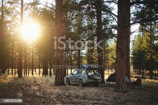 Christmas Valley, Oregon, USA - September 20, 2018: A young man sits at a dispersed campsite in the central Oregon wilderness.