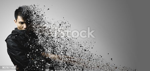 istock dispersion effect of asian man body shattering 902921838