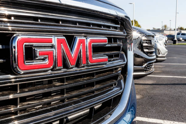GMC SUV display at a Buick GMC dealership. GMC focuses on upscale trucks and utility vehicles and is a division of GM stock photo