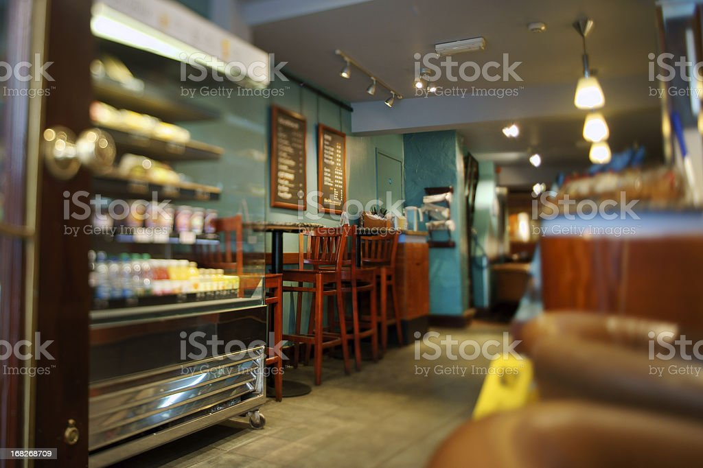 Display case and furniture in interior of cafe stock photo