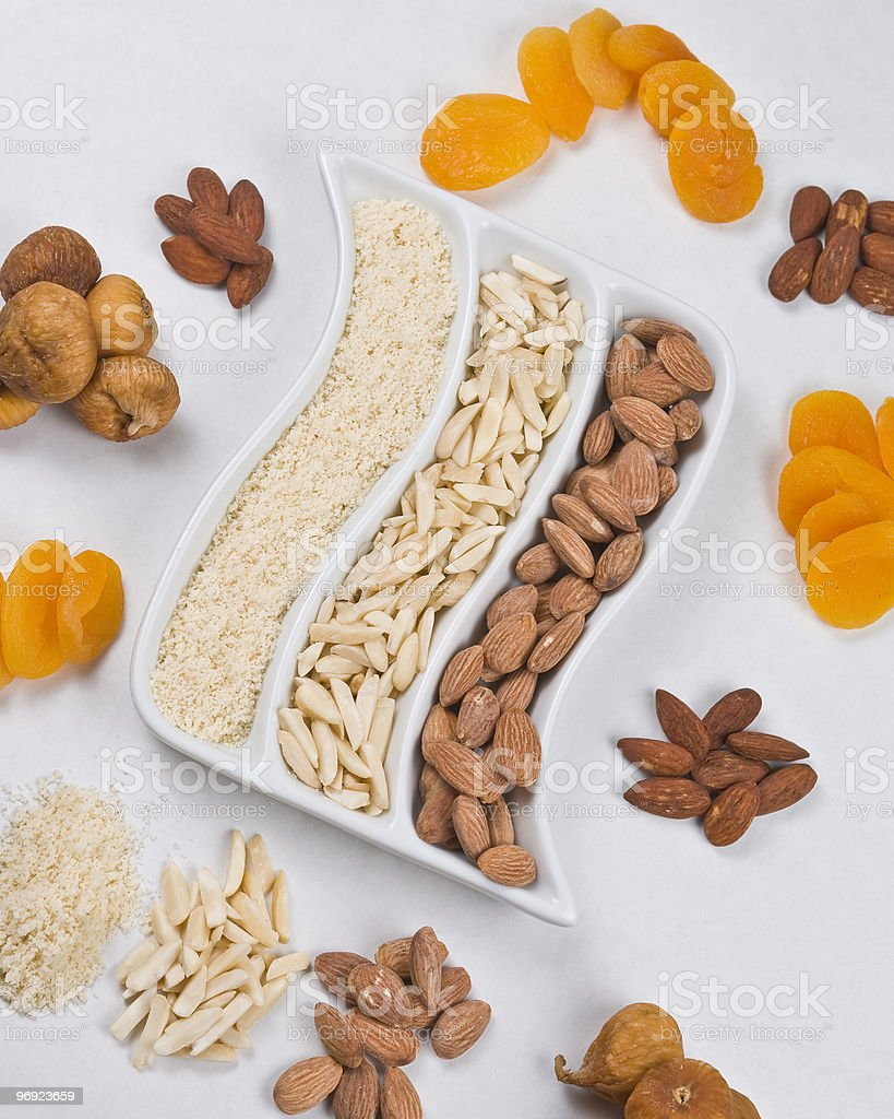 Display of almonds and dried fruit [n] royalty-free stock photo