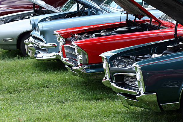 display of classic automobiles at indiana car show.  colorful.  summer. - classic cars stock photos and pictures