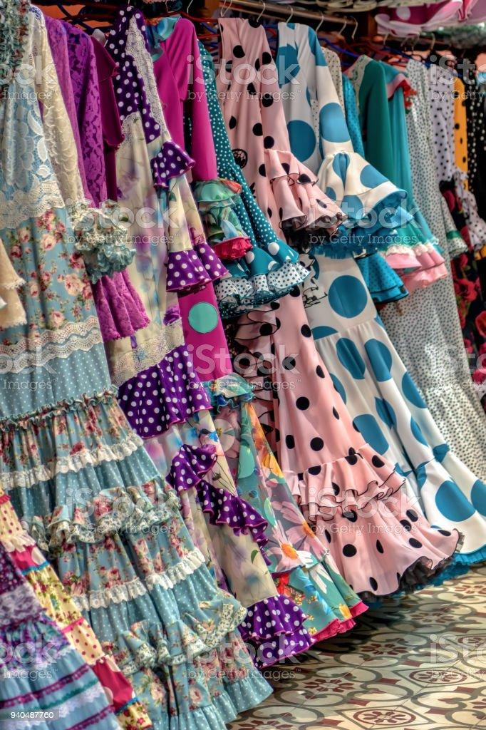 Display of colorful flamenco dancer dresses. stock photo