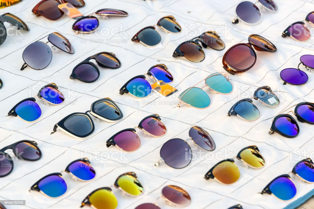 Display of colorful sunglasses for sale in a street stock photo