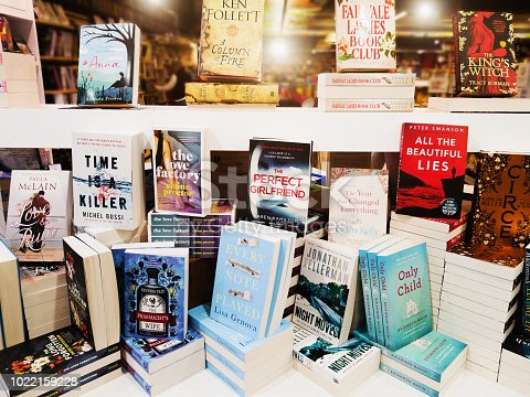 istock Display of contemporary fiction books in store window 1022159228