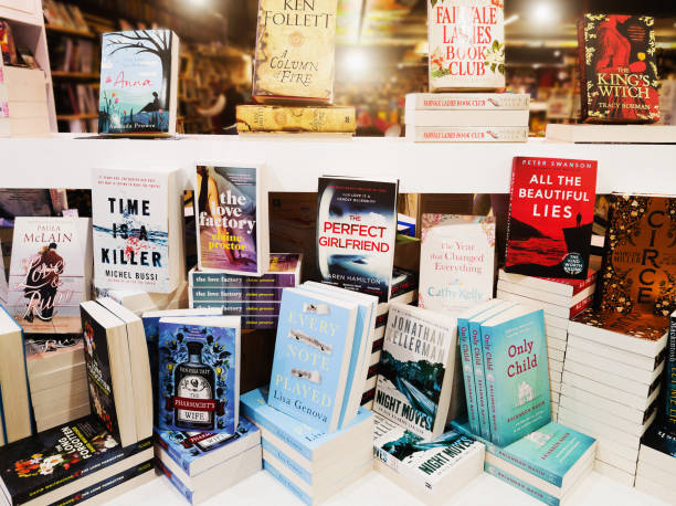 display of contemporary fiction books in store window - bookstore stock pictures, royalty-free photos & images