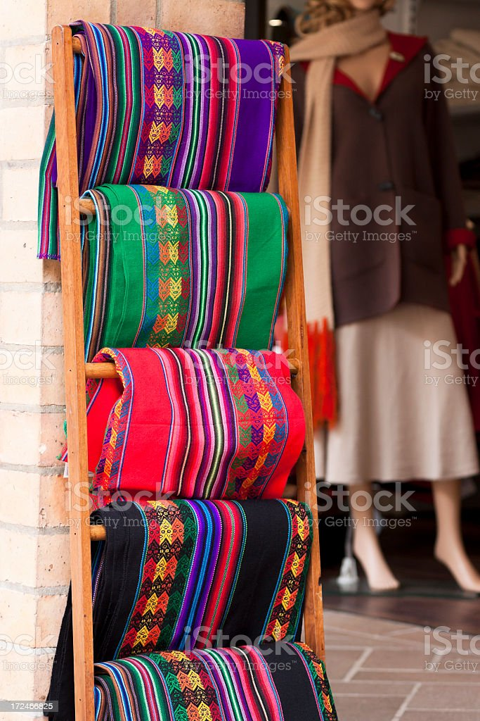 Display of exotic colourful material on wooden stand royalty-free stock photo