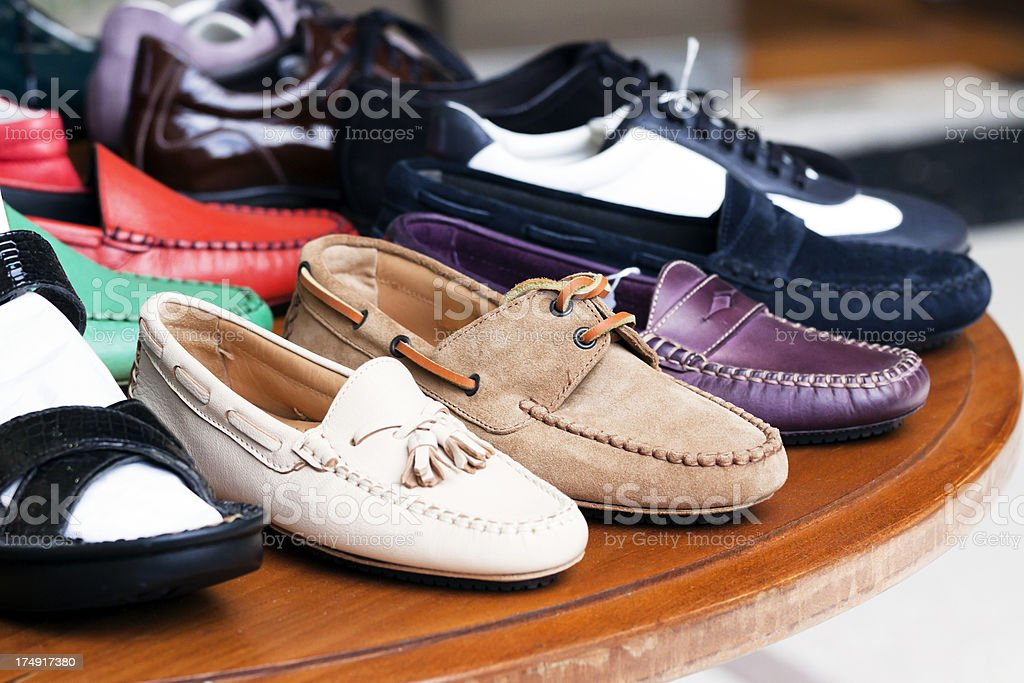 Display of female shoes in the shop on wooden table royalty-free stock photo