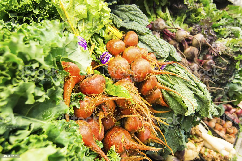 Display of fresh vegetables - Beets, turnips, lettuce stock photo