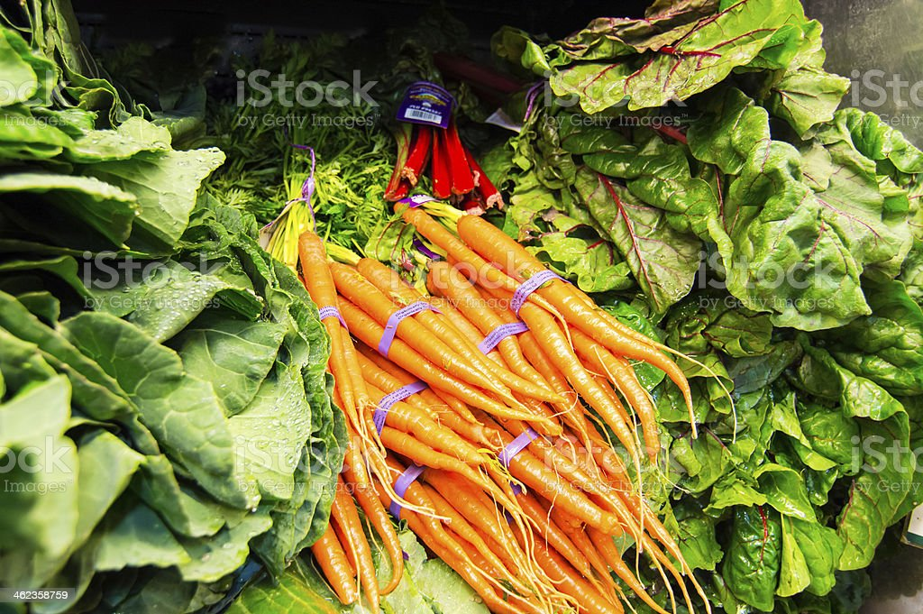 Display of fresh vegetables - Carrots, Lettuce, Greens stock photo