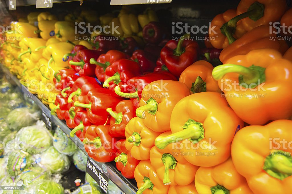 Display of fresh vegetables - Red, yellow, orange Bell Peppers stock photo