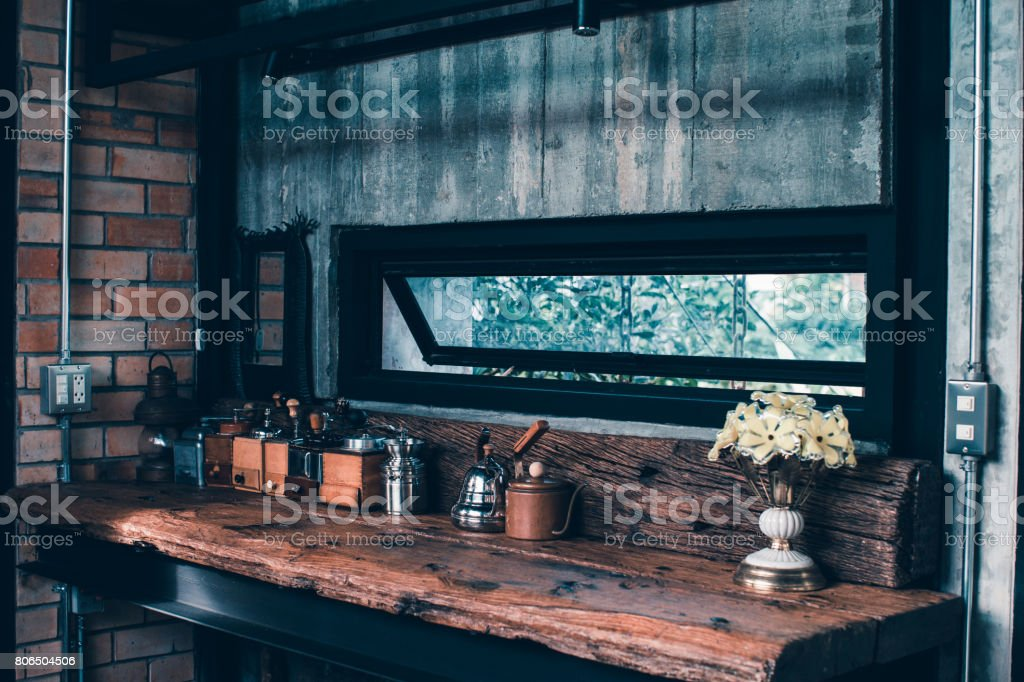 Display of Hand Coffee Grinder decoration on counter bar at home loft style stock photo