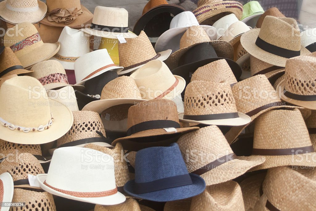Display of hats in a street market stall. stock photo
