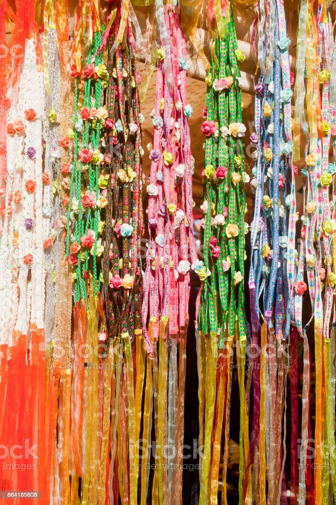 Display of multicolored flower wreaths with ribbons. royalty-free stock photo