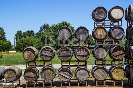 Stacked Display Of Old Wooden Wine Barrels At Local Winery