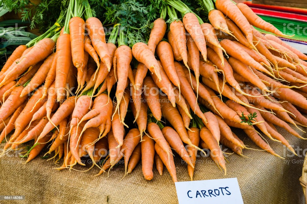 Display of orange carrots at the market zbiór zdjęć royalty-free