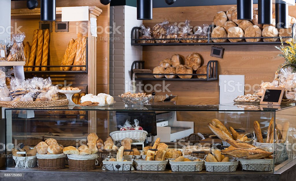 Display of ordinary bakery with bread and buns stock photo