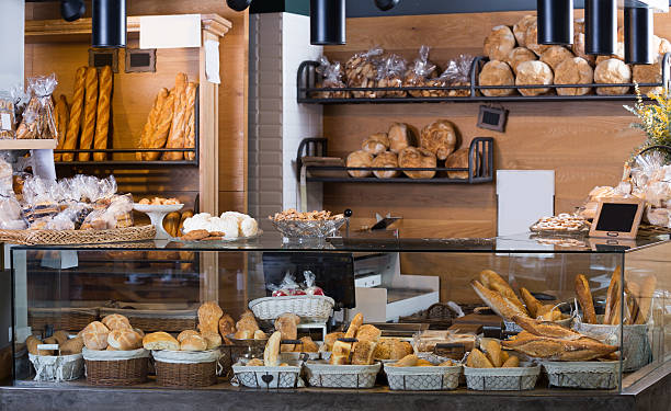 display of ordinary bakery with bread and buns - bakker stockfoto's en -beelden
