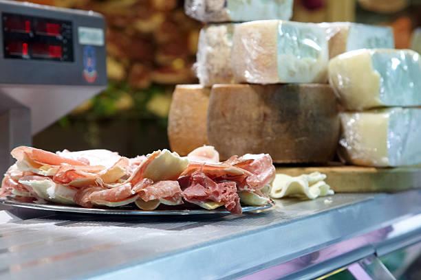 Display of parma hams and cheeses stock photo