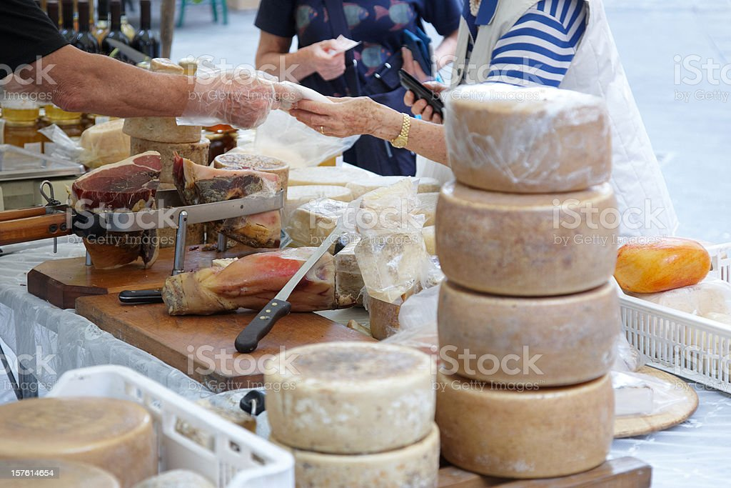 Display of parma hams and cheeses purchase stock photo