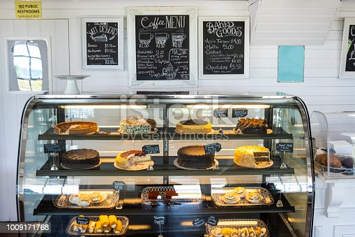 Luscious pastries and baked good in a retail display case in a cafe bakery coffee shop.