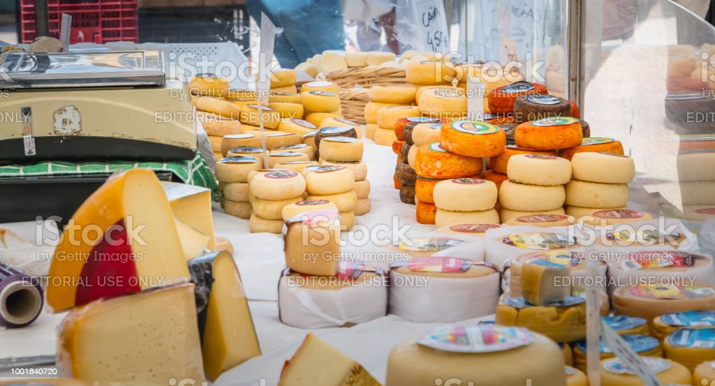Display Of Portuguese Cheeses On An Outdoor Municipal Market