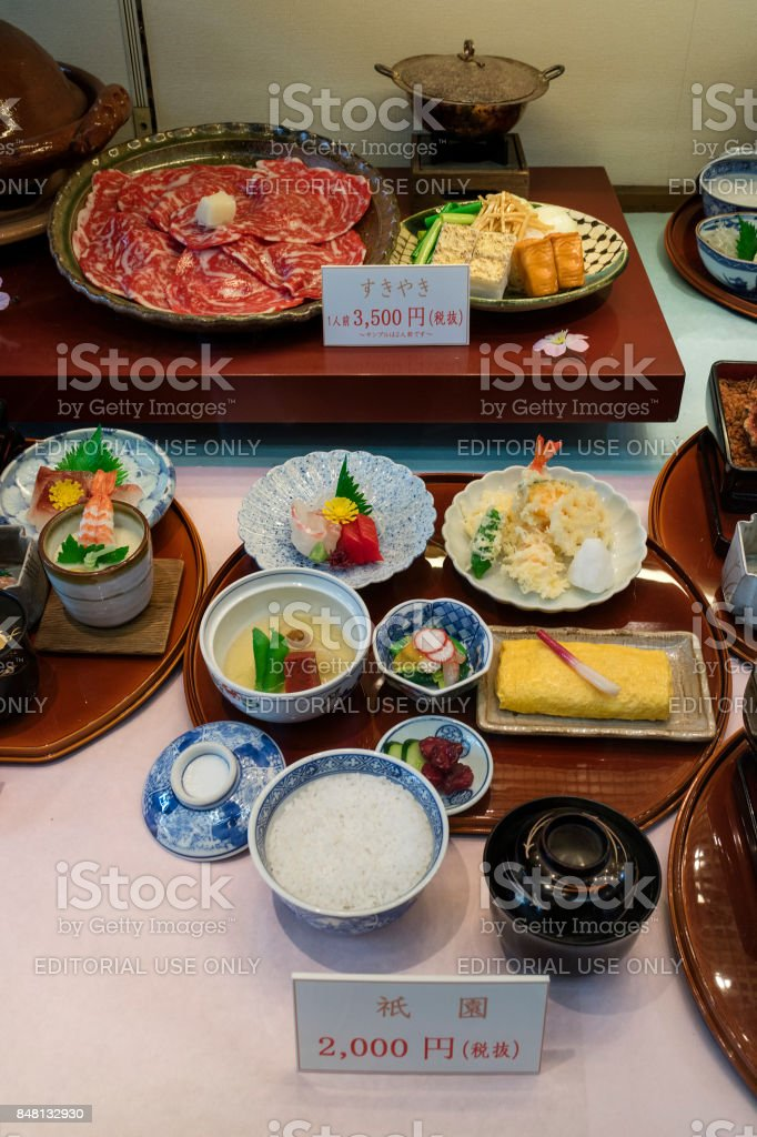Display of replica food in front of a restaurant stock photo